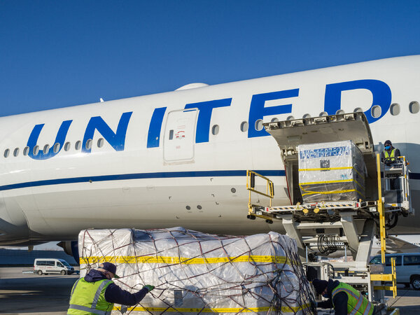 Ramp service crews unloaded cargo from United Airlines plane O'Hare International Airport in Chicago in December.