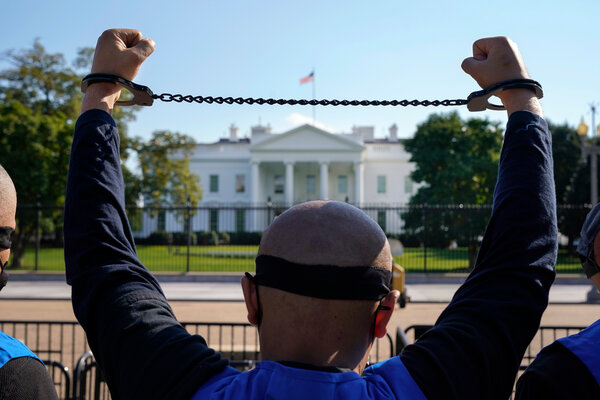 A member of the Uyghur American Association rallying in front of the White House last year.