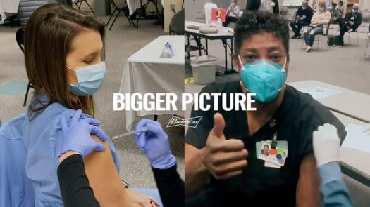 Budweiser's Covid-19 awareness advertisement includes two health workers who were being vaccinated.