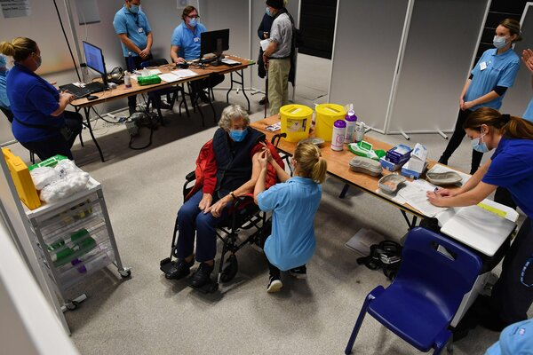 A patient receiving an injection of the AstraZeneca-Oxford vaccine on Tuesday in Brighton, Britain.