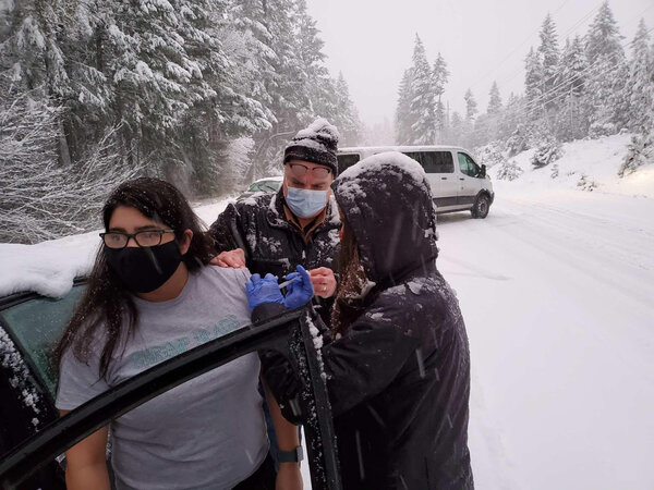 An impromptu roadside vaccination in rural southern Oregon during a snowstorm, when public health workers realized their remaining doses of vaccine would expire while they were stranded.