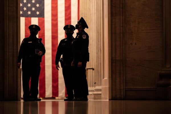 Capitol Police officers standing by the Capitol's rotunda on Monday.