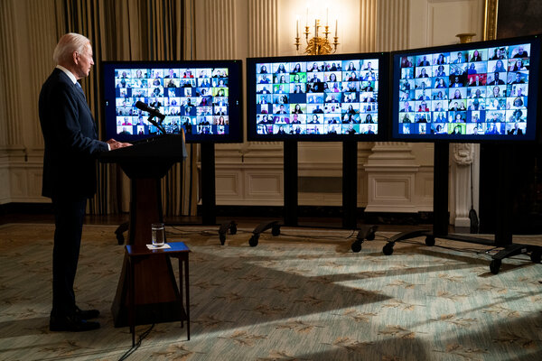 President Biden swore in members of the White House staff remotely on Jan. 20.