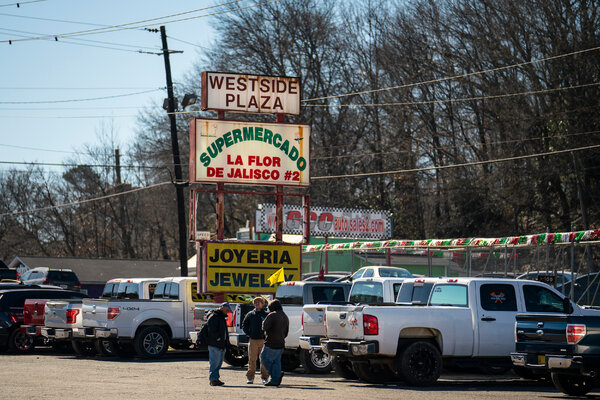 """Day workers gathered atthe Supermercado La Flor de Jalisco #2.""""People are going to be a lot more afraid to go to work in those places now,"""" one worker said of the chicken plants that are a crucial source of employment."""
