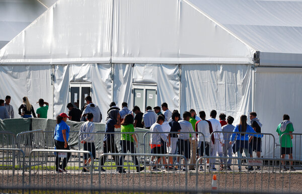 Children lined up to enter a tent at the Homestead Temporary Shelter for Unaccompanied Children in Homestead, Fla.