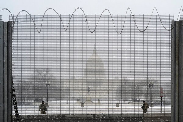 National Guard members on duty on Sunday at the U.S. Capitol, which is now protected by fencing.