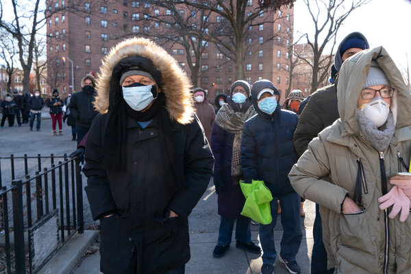 People in the Bronx waiting to get vaccinated for the coronavirus on Saturday. A winter storm is expected to disrupt vaccinations across the Eastern United States.