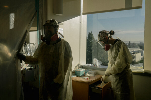 The hospital turned an entire medical ward into an I.C.U., with two patients to a room and and thick plastic sheets over the doorways.