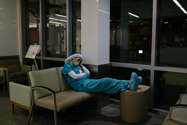 A staff member sleeping in the lobby during a break at 2 a.m.