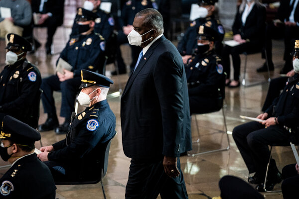 Defense Secretary Lloyd Austin attending a congressional tribute to the late Capitol Police officer Brian Sicknick, who lay in honor in the Capitol Rotunda on Wednesday.