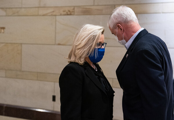 Representative Liz Cheney, Republican of Wyoming, speaks with Representative Steve Womack, Republican of Arkansas, on their way to the House floor for a vote on Wednesday.