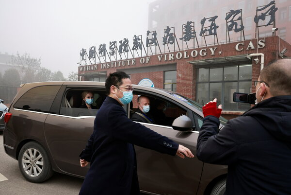Members of the World Health Organization team arriving at the Wuhan Institute of Virology in China on Wednesday. Thecenter houses a state-of-the-art laboratory known for its research on coronaviruses.