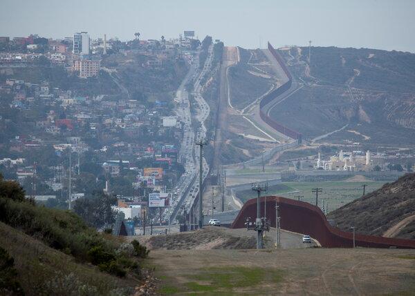 The border wall between Tijuana, left, and California.