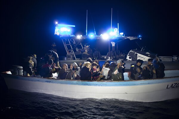 The C.B.P. intercepting the Lazora, a Mexican vessel containing 20 people.
