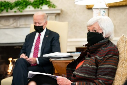 Treasury Secretary Janet Yellen in the Oval Office in January. On Monday, she said she didn't believe President Biden's stimulus package would cause higher inflation.