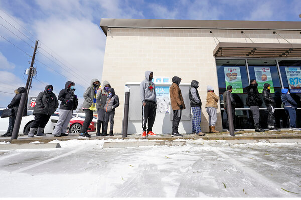 Lining up to buy groceries in Houston, Texas, on Monday.Mayor Sylvester Turner of Houston said on Twitter that city residents whose lights had gone out may be without electricity all day.