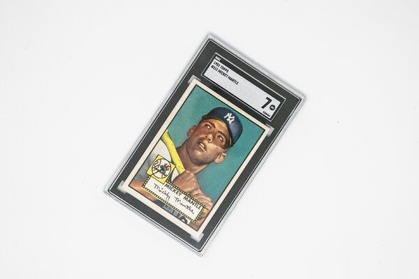 Mickey Mantle's 1952 Topps rookie card is one of the most sought-after cards. While a Mantle with a rating of SGC 7 like this one is valuable, a version of the same card rated PSA Mint 9 recently sold for $5.2 million.