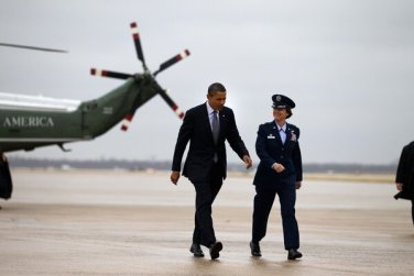 Gen. Jacqueline D. Van Ovost of the Air Force with President Barack Obama at Joint Base Andrews in 2011.