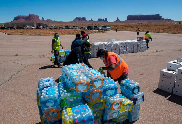 Navajo Nation volunteers prepared to distribute drinking water to families in need outside Monument Valley Tribal Park in Arizona in the spring.