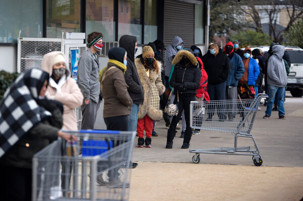 Customers waited in a long line outside a Kroger Grocery store in Houston on Wednesday. Food banks are facing dwindling supplies from grocery stores, their main source of donated food.