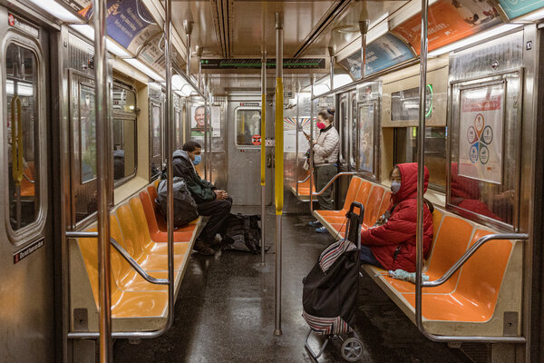 Riding the subway in Manhattan on Monday. New York and New Jersey are adding cases at rates higher than every state except South Carolina.
