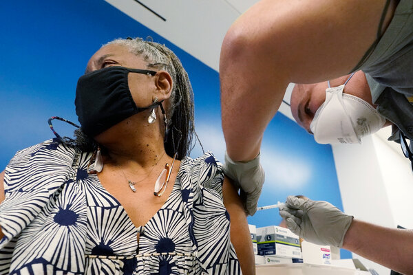 Florida has largely left its population in the dark about which groups would be vaccinated after people 65 and older. Above, Peachie Tresvant, 68, getting her shot last month at Jackson Memorial Hospital in Miami.