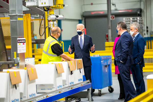 President Biden touring a Pfizer manufacturing site on Friday in Kalamazoo, Mich.