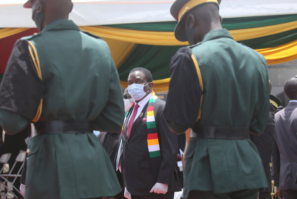 """""""The time shall come when those who are not vaccinated won't get jobs,"""" said President Emmerson Mnangagwa of Zimbabwe, center."""