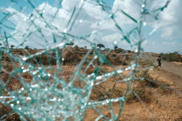 A woman is seen through the shattered windshield of a military truck that belonged to Tigrayan forces.