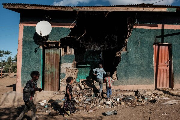 Children playing in front a house in the Tigray region that was damaged in fighting in December.