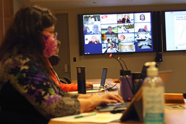 University of Hawaii employees monitor a Board of Regents meeting via Zoom. The teleconference company's revenue surged more than 300 percent in its fiscal year.