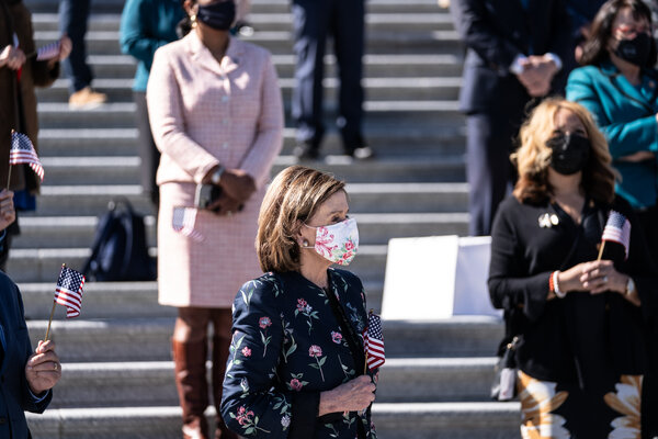 House Speaker Nancy Pelosi, listens during an event promoting H.R. 1, the For the People Act of 2021, on the steps of the Capitol.
