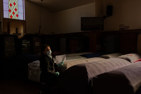 Maria Hernandez, a prep room assistant, sorting through the coffins that fill the funeral home's chapel.
