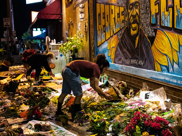 Volunteers organizing flowers at the memorial for George Floyd outside of Cup Foods in Minneapolis in the week following his death.