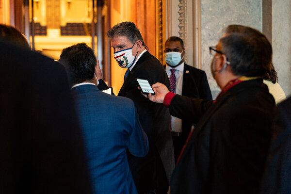 Senator Joe Manchin walks to the Senate Chambers on Friday.