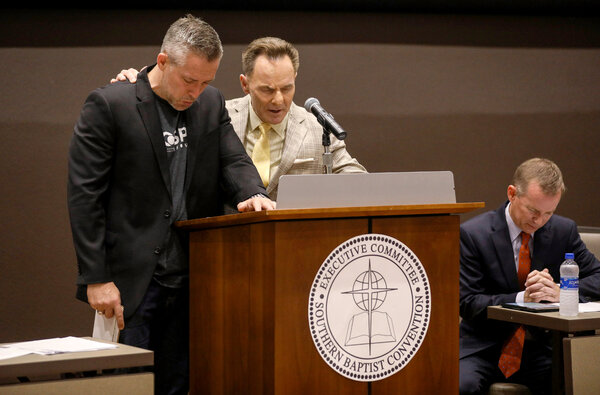 J.D. Greear, the president of the Southern Baptist Convention, left, with Ronnie Floyd, the president and chief executive of the convention's Executive Committee, at the annual meeting in Birmingham, Ala., in 2019. Both men have publicly lamented Ms. Moore's departure.