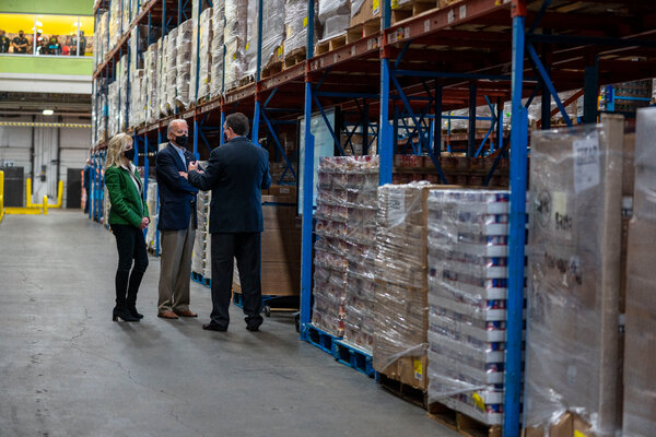 President Biden touring the Houston Food Bank. Aids say he has shifted his focus to addressing the inequities that the pandemic has inflicted on the poorest Americans.