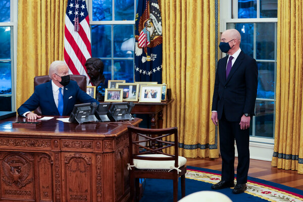 """President Biden with his new homeland security secretary, Alejandro N. Mayorkas, who said this month that the administration's message was not """"don't come"""" but rather """"don't come now."""""""