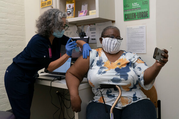 Denise Saylor photographed herself as Lara Comstack injected her with vaccine in January at the Callen-Lorde Community Health Center in Manhattan.