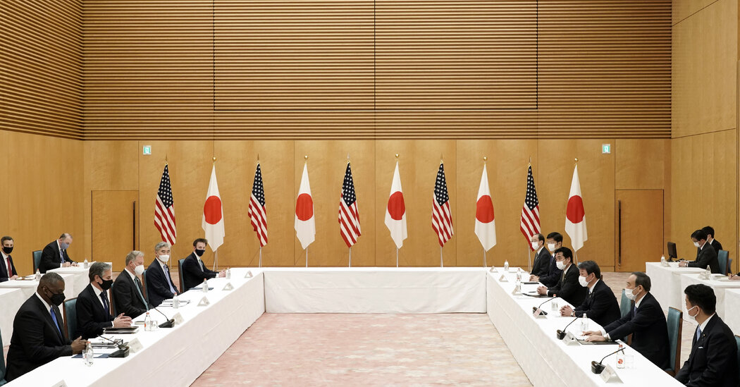 Top U.S. officials strike a critical tone toward China during a visit to Japan.