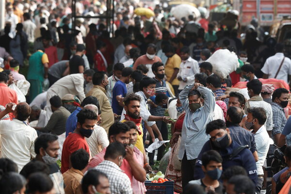 A crowded market in Mumbai, India, on Friday. The surrounding state ofMaharashtra is at the center of a new coronavirus outbreak.