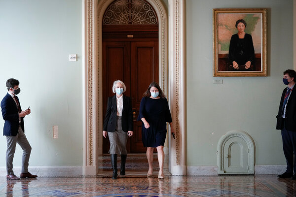 The Senate's new sergeant at arms, Lt. Gen. Karen Gibson, center left, walks to her ceremonial swearing-in at the Capitol on Monday with her chief of staff, Jennifer Hemingway.