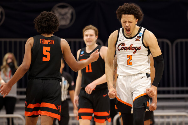 Cade Cunningham, right, is expected by some analysts to be taken with the top seed in the N.B.A. draft.