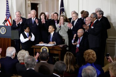 President Barack Obama signing the Affordable Care Act in 2010 at the White House.