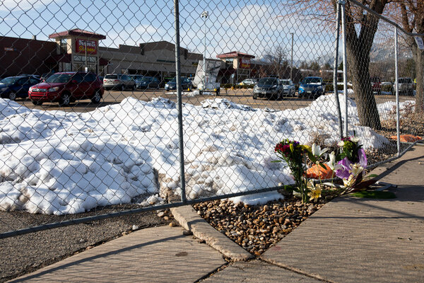 Flowers were left on Tuesday at a makeshift memorial for the victims of the mass shooting at King Soopers in Boulder, Colo.