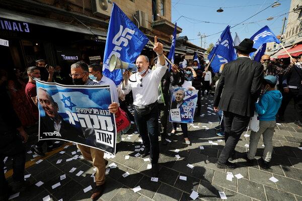 Likud supporters campaigned for Prime Minister Benjamin Netanyahu in Jerusalem last week. Mr. Netanyahu will remain caretaker prime minister during negotiations.