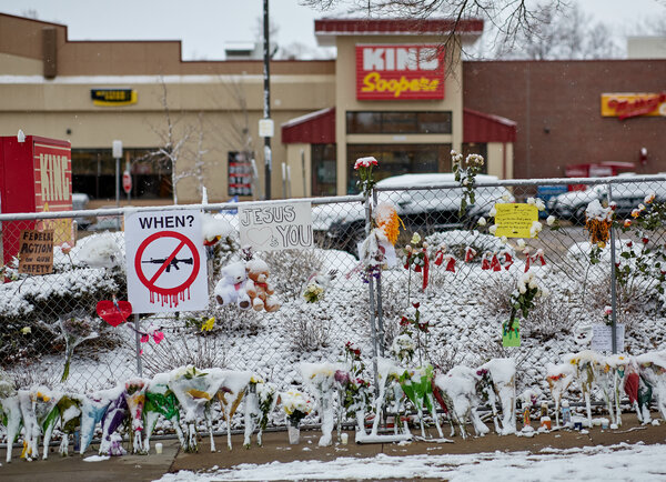 A dusting of snow coats the makeshift memorial at King Soopers in Boulder, Colo.