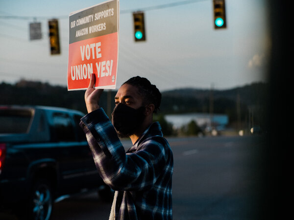 Kumasi Amin, 26, canvassing at the entrance to an Amazon facility in Bessemer, Ala., earlier this month. President Biden has expressed support for workers trying to unionize.