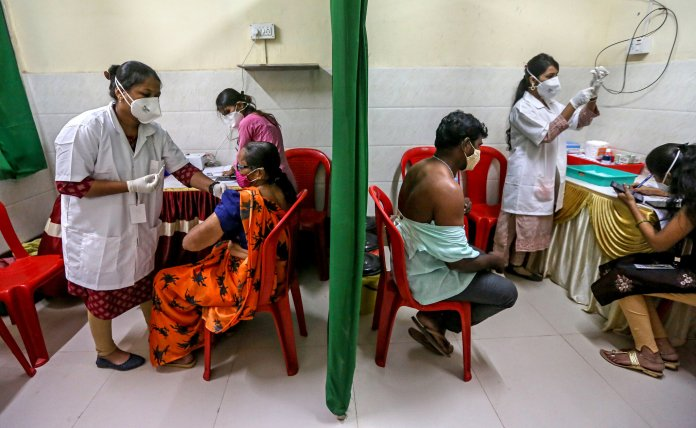 India Cuts Back on Vaccine Exports as Infections Surge - The New York Times