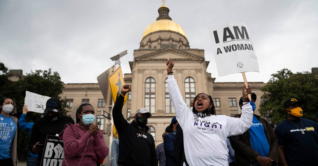 Georgia Law Kicks Off Partisan Battle Over Voting Rights
